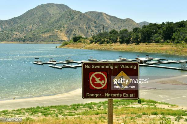 A sign warns visitor of hazards for swimming and wading at Lake Piru where actress Naya Rivera was reported missing Wednesday on July 9 2020 in Piru...