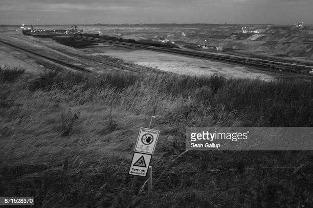 A sign warns visitors not to advance further at the edge of the Garzweiler openpit coal mine on November 4 2017 near Jackerath Germany The COP 23...