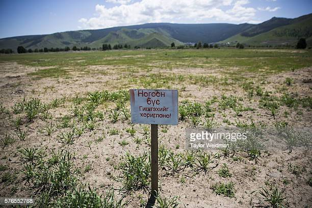 A sign warns visitors not to walk on newly planted grass during a cricket nets session at MACA Mongolian Friendship Cricket Ground on July 16 2016 in...