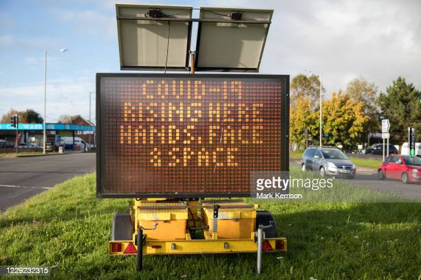 Sign warns visitors to the town of rising numbers of local cases of the coronavirus and of the need to follow the Governments Hand Face And Space...