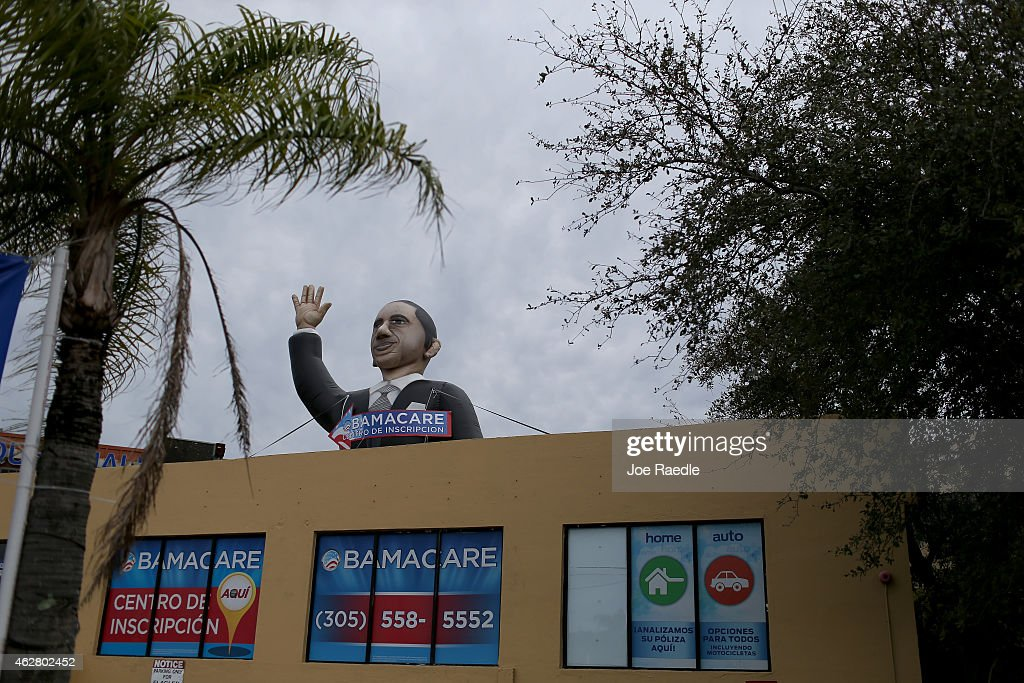 A sign waves from the top of insurance co. roof advertising for the Affordable Care Act, also known as Obamacare, as the company tries to sign people up before the February 15th deadline on February 5, 2015 in Miami, Florida. Numbers released by the government show that the Miami-Fort Lauderdale-West Palm Beach metropolitan area has signed up 637,514 consumers so far since open enrollment began on Nov. 15, which is more than twice as many as the next large metropolitan area, Atlanta, Georgia.