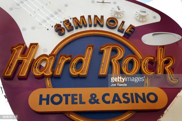 A sign welcomes people May 11 2004 during the grand opening for the Seminole Hard Rock Hotel and Casino in Hollywood Florida South Florida's Seminole...