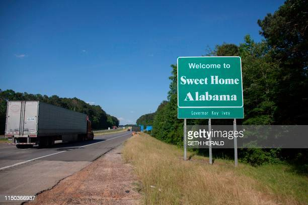A sign welcomes people to the state of Alabama May 182019 Alabama's Governor Kay Ivey passed the most restrictive abortion law in the Untied States...