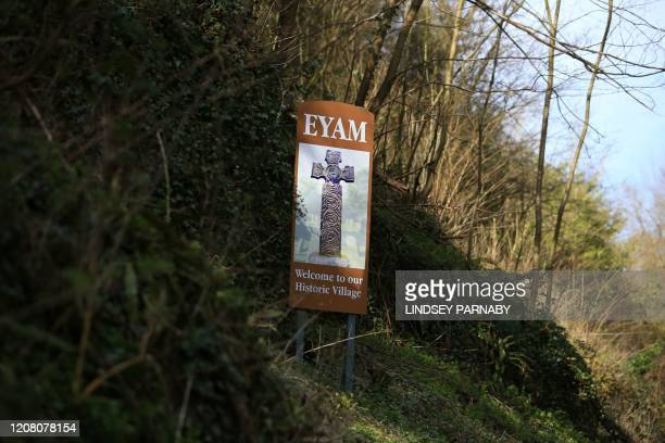 Sign welcomes people to the village of Eyam in Derbyshire, northern England on March 23, 2020. - In the 17th century, the inhabitants of Eyam got rid...