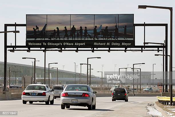 A sign welcomes travelers to O'Hare International Airport on an expressway near the airport March 3 2005 in Chicago Illinois According to the US...