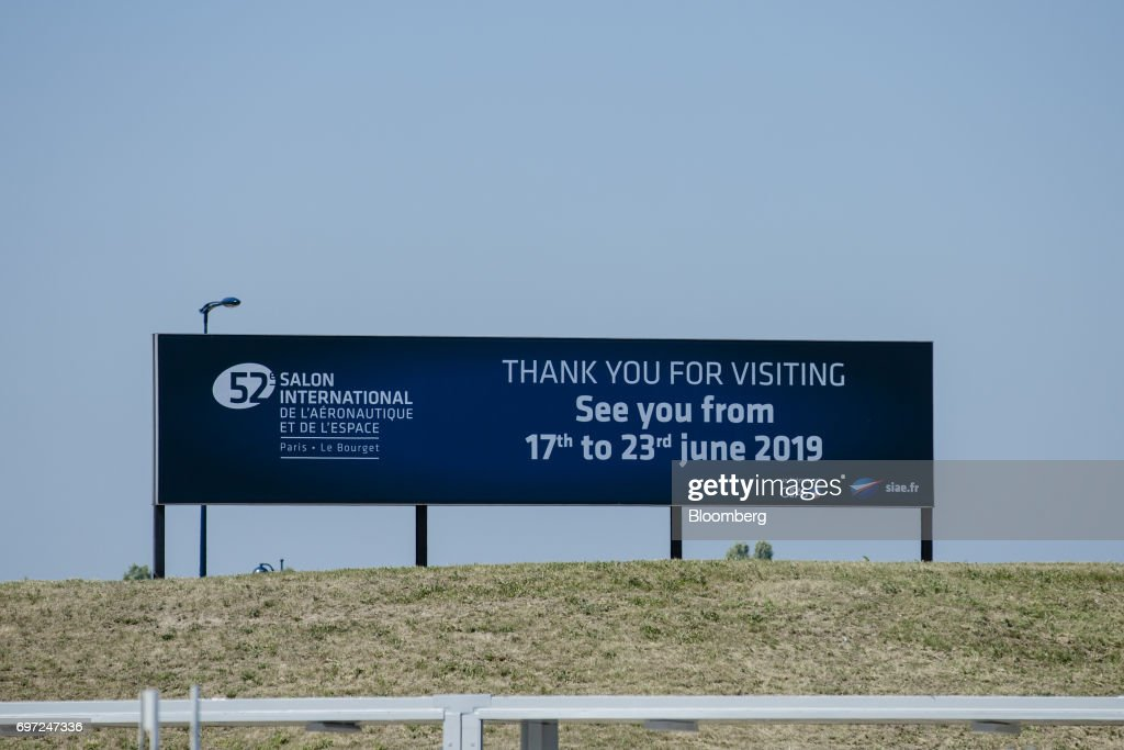 A sign welcomes visitors ahead of the 53rd International Paris Air Show at Le Bourget, in Paris, France, on Sunday, June 18, 2017. The show is the world's largest aviation and space industry exhibition and runs from June 19-25. Photographer: Marlene Awaad/Bloomberg via Getty Images