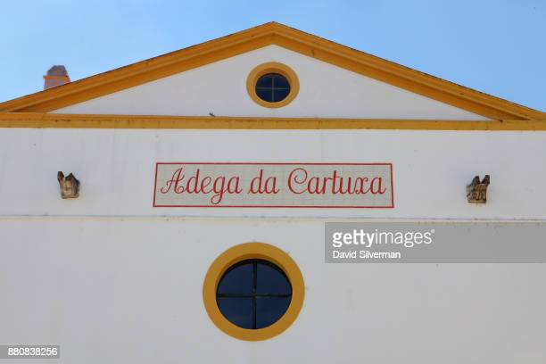 A sign welcomes visitors to the Adega da Cartuxa winery on September 30 2016 in the city of Evora in the Alentejo province of Portugal Cartuxa which...