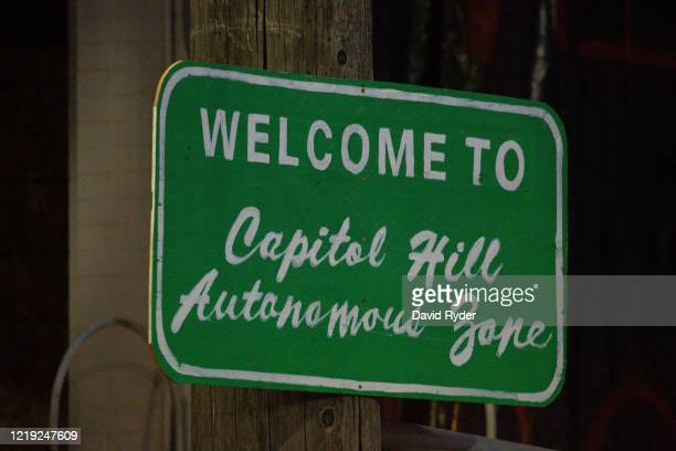 "Sign welcomes visitors to the so-called ""Capitol Hill Autonomous Zone"" on June 10, 2020 in Seattle, Washington. The zone includes the blocks..."