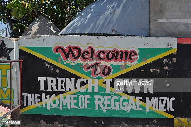 TANDONA sign welcomes visitors to Trench Town the rough home neighborhood of reggae legend Bob Marley in Kingston Jamaica on May 29 2010 Bob Marley...