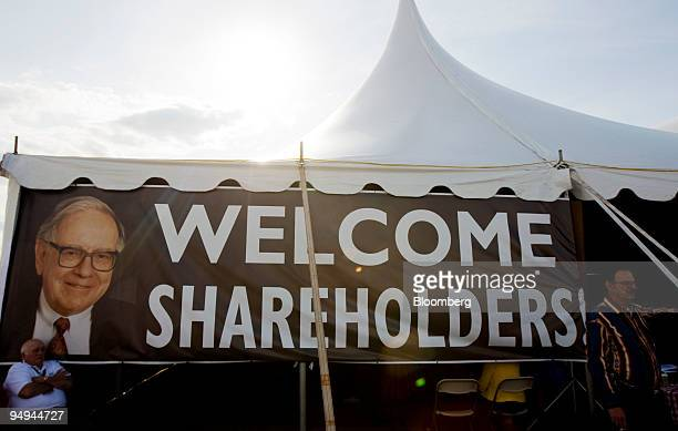 A sign welcoming shareholders to Warrens Western Cookout as past of the Berkshire Hathaway Inc annual shareholder meeting is displayed outside a tent...