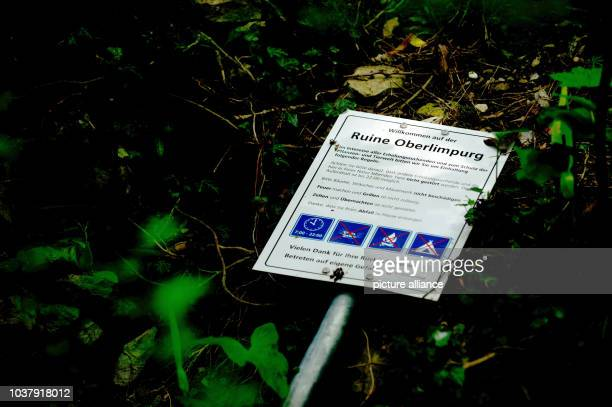 A sign which promotes the ruin Oberlimpurg lies on the ground in Schwaebisch Hall Germany 07 May 2013 According to the media which report on...