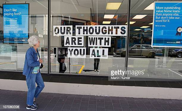 A sign which reads Our thoughts are with you all is displayed in a Greymouth Streets in support of the 29 miners and contractors trapped in the Pike...