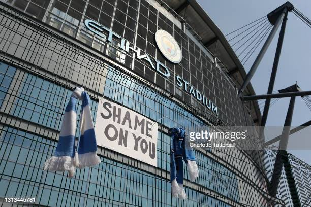 Sign which reads 'Shame On You' is placed between two Manchester City scarves outside the Etihad Stadium on April 20, 2021 in Manchester, England....