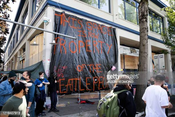 A sign which reads this is property of the Seattle people is pictured on the closed Seattle Police Department's East Precinct now surrounded by the...