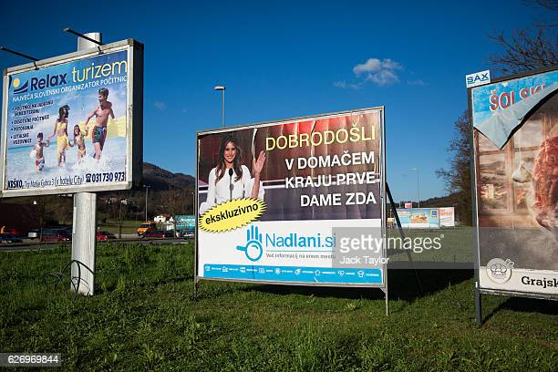 A sign which reads 'Welcome to the Hometown of the First Lady' in Slovenian is pictured among other billboards on November 29 2016 in Sevnica...