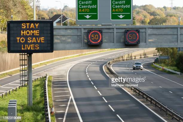 """Sign which says """"stay at home to save lives"""" on the A470 southbound on October 26, 2020 in Cardiff, Wales. Wales entered a national lockdown on..."""