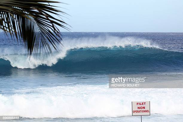A sign which translates 'Net nonoperational' is pictured on August 28 2016 on the Boucan Canot beach on the Indian Ocean island of La Reunion a day...