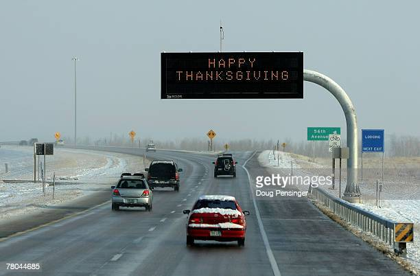 A sign wishes travelers a happy thanksgiving on the Pena Boulevard airport access highway at the Denver International Airport on November 21 2007 in...