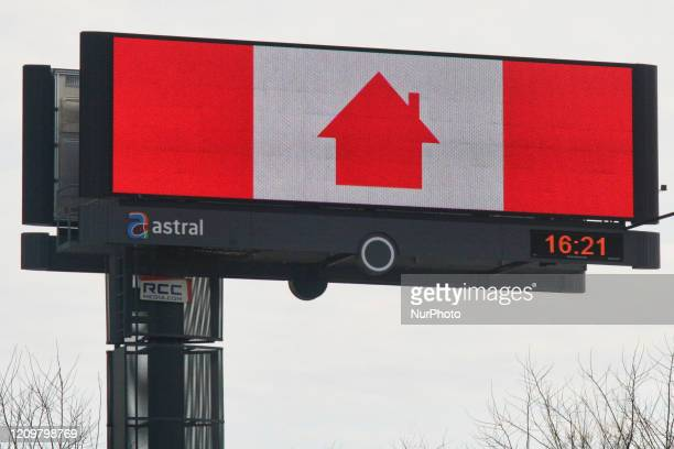 Sign with a Canadian flag urging Canadians to stay at home to slow the spread of the novel coronavirus in Vaughan Ontario Canada on April 12 2020 The...