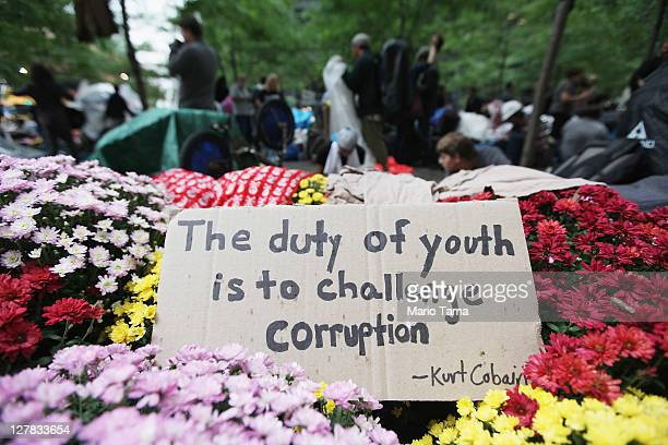 A sign with a quote by Kurt Cobain written on it sits in Zuccotti Park along with members of the Occupy Wall Street movement before they marched to...