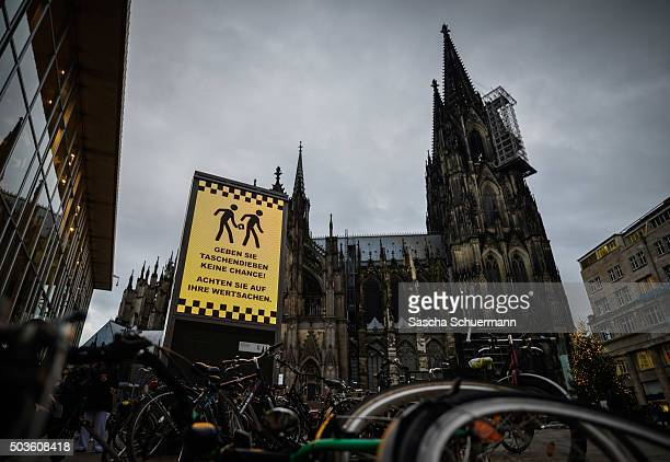 A sign with a warning against pickpockets is displayed in front of Hauptbahnhof main railway station on January 6 2015 in Cologne Germany 90 women...