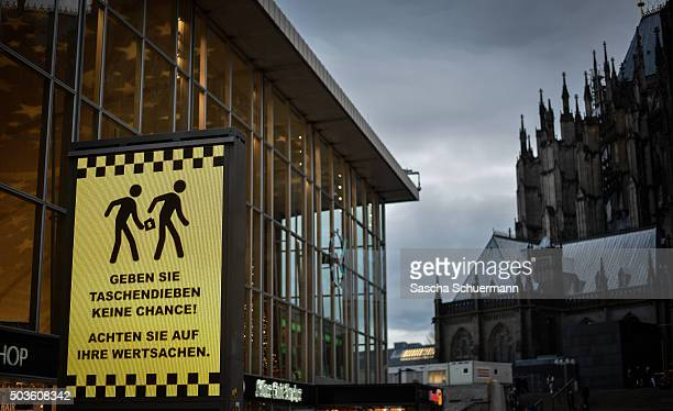 A sign with a warning against pickpockets stand in front of Hauptbahnhof main railway station on January 6 2015 in Cologne Germany 90 women have...