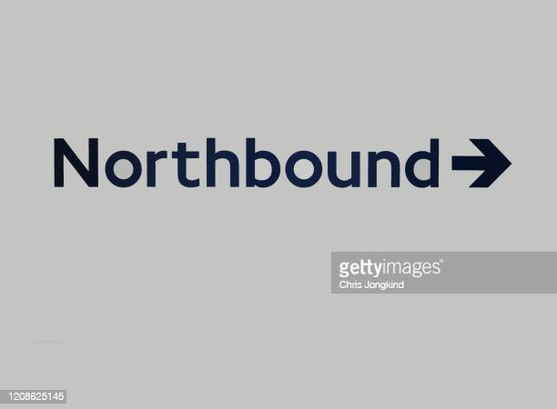 sign with arrow pointing to 'northbound' - northern rail stock pictures, royalty-free photos & images