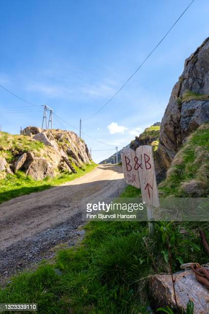 sign with bed & breakfast beside a road in fishingvillage nyksund, vesterålen norway - finn bjurvoll stock pictures, royalty-free photos & images
