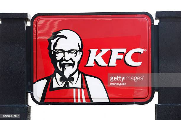 kfc sign with black posts - colonel sanders stock photos and pictures