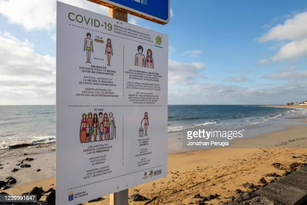 Sign with Covid-19 rules stands in front of a deserted beach in Playa Matagorda, Lanzarote, Spain on 22nd November 2020. Beaches and resorts across...