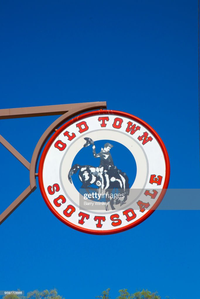 Sign with cowboy and horse above street in Old Town, Scottsdale, AZ : Stock-Foto