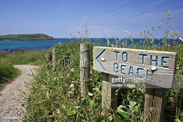 Sign with directions to the beach