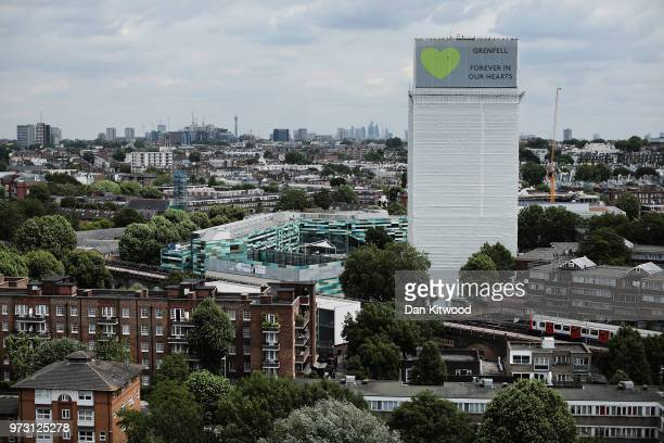 A sign with 'Grenfell Forever In Our Hearts' is displayed on the top of Grenfell Tower on June 13 2018 in London England Tomorrow marks the one year...