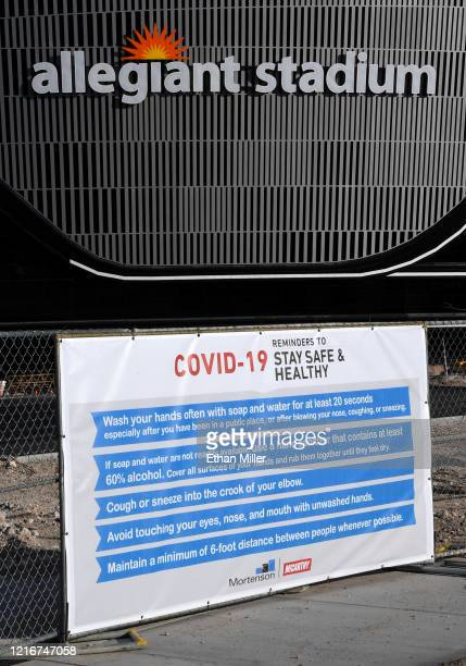 A sign with guidelines for how to stay safe from the coronavirus is posted on a fence at Allegiant Stadium as construction continues on the USD 2...