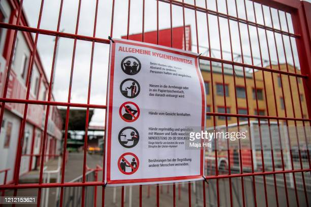 Sign with hygiene instructions hangs on door outside of the Stadion An der Alten Foersterei on March 13, 2020 in Berlin, Germany. The German football...