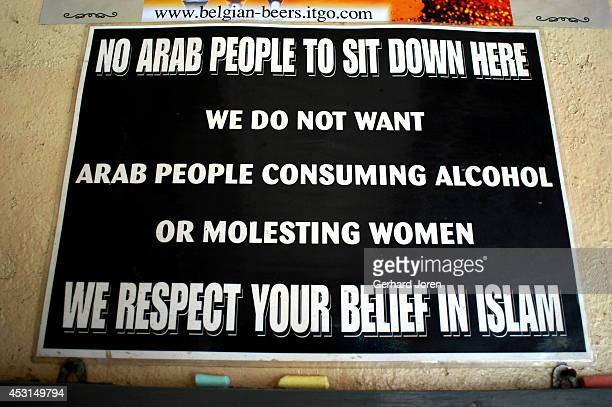 A sign with little attention to political correctness banning Arabs in an Australian bar on Walking Street Pattaya is a seaside resort city a couple...
