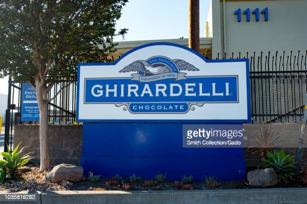 Sign with logo for iconic San Francisco gourmet chocolate company Ghirardelli at the company's factory and headquarters in San Leandro California...