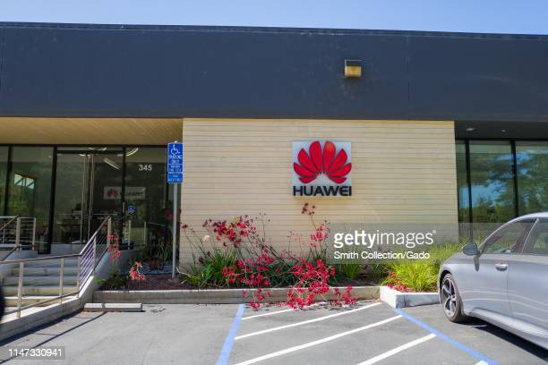 Sign with logo on facade of office of Chinese networking equipment company Huawei in the Silicon Valley Mountain View California May 3 2019