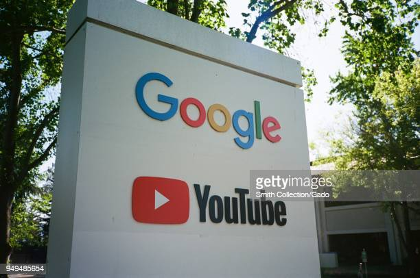Sign with logos for Google and the Google owned video streaming service YouTube at the Googleplex, the Silicon Valley headquarters of search engine...