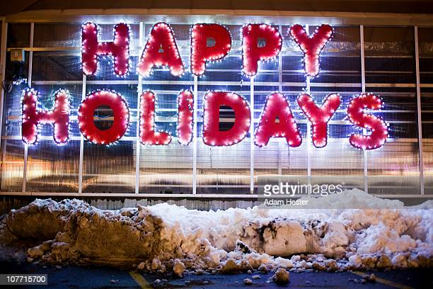 a happy holidays sign with plowed snow. - happy holidays stock photos and pictures
