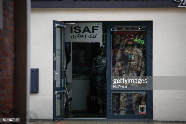 A sign with the acronym for the NATO security mission for security in Afghanistan with an Arabic text is seen at a military supply shop in Bydgoszcz...