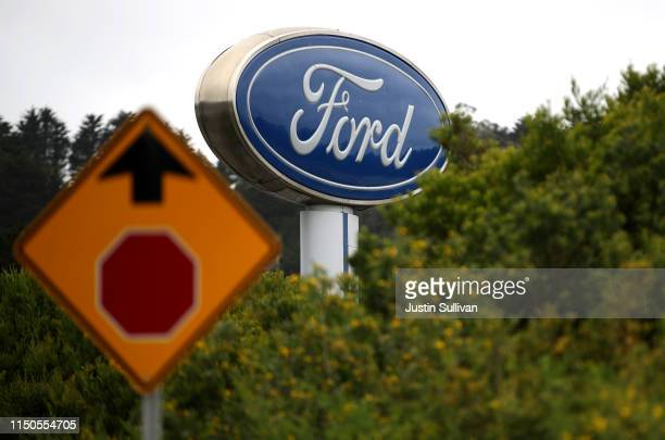 A sign with the Ford logo is posted in front of Serramonte Ford on May 20 2019 in Colma California Ford Motor Company announced plans to lay off 7000...