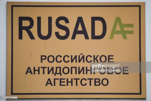 A sign with the logo of the Russian antidoping agency is seen on a building housing its offices in Moscow on December 9 2019 The World AntiDoping...