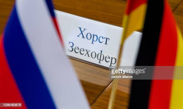 A sign with the name of Horst Seehofer the premier of the German state of Bavaria in Cyrillic script in Moscow Russia 17 March 2017 The minister is...