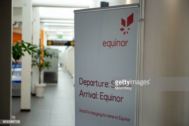 A sign with the new Equinor ASA logo stands at an airport in Stavanger Norway on Wednesday May 16 2018 Statoil has changed its name to Equinor to...