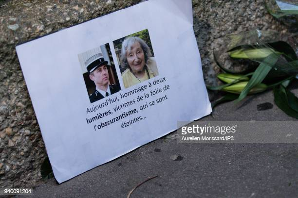 A sign with the portraits of Mireille Knoll and Arnaud Beltrame who died during the Trebes attacks at the Silent March In Memory Of Mireille Knoll...