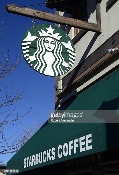 A sign with the Starbucks Coffee logo hangs over the entrance to a Starbucks shop in Durango Colorado