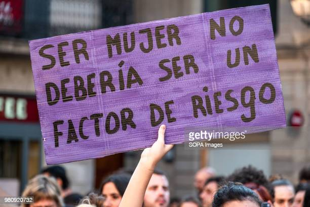 A sign with the text being a woman should not be a risk factor is seen during the protest After hearing the sentence given by the court to the...