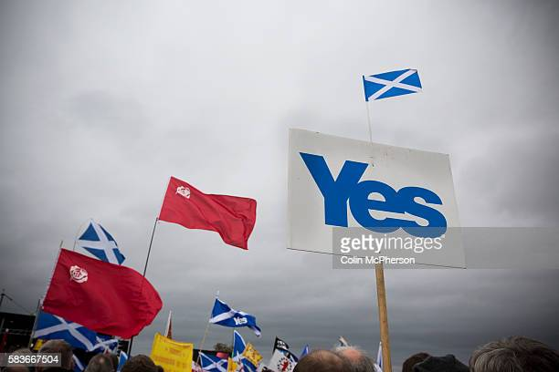 A sign with the word 'Yes' is hoisted amongst crowds listening to speeches on Calton Hill in Edinburgh during a proIndependence march and rally in...