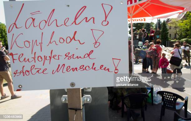 A sign with the writing 'Smile Head up Flood victims are proud people' is pictured in the quarter Laubegast in Dresden Germany 05 June 2013 Photo...
